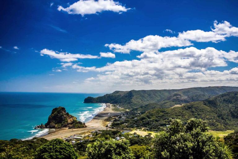 Piha Beach landscape featuring on our New Zealand selfie spots list.